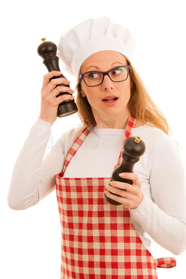 Uncertain chef with salt and pepper grinder isolated over white stock photos