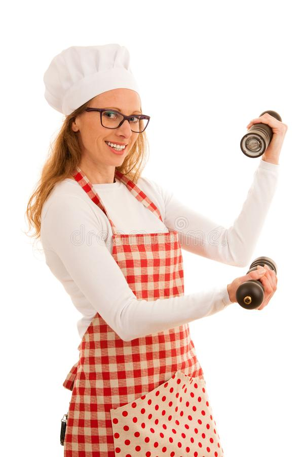 Uncertain chef with salt and pepper grinder isolated over white stock photography
