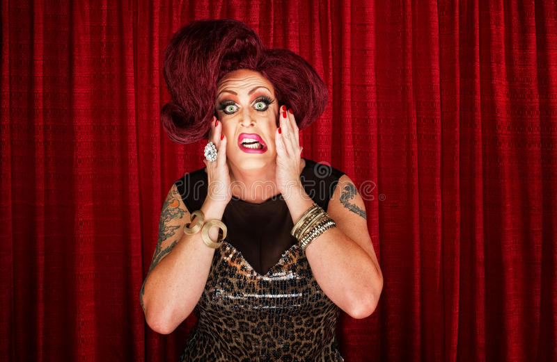 Uncertain Drag Queen. With hands on face stock photography