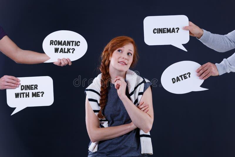 Uncertain girl and speech balloons stock image