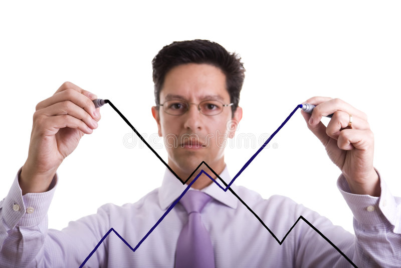 Uncertainty market evolution. Businessman drawing an uncertainty market evolution (selective focus royalty free stock images