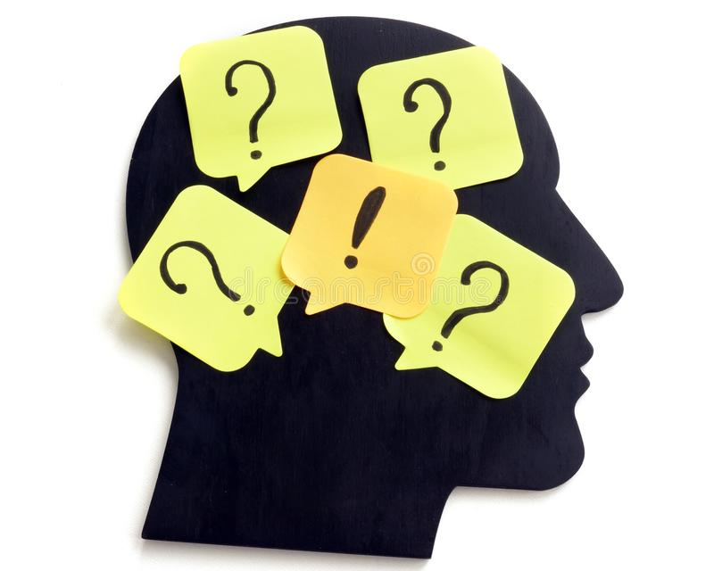 Uncertainty, thoughts and creativity. Head shape with question marks stock images