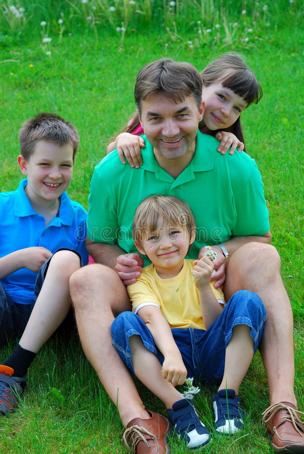 Uncle And Children In A Meadow royalty free stock image