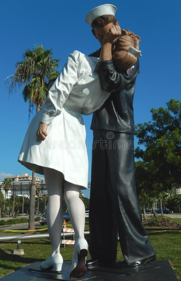 Unconditional Surrender - Sculpture by J. Seward Johnson 2006, Sarasota, Florida. The celebrants in Times Square in New York City on 8/14/45 when the Japanese royalty free stock photos