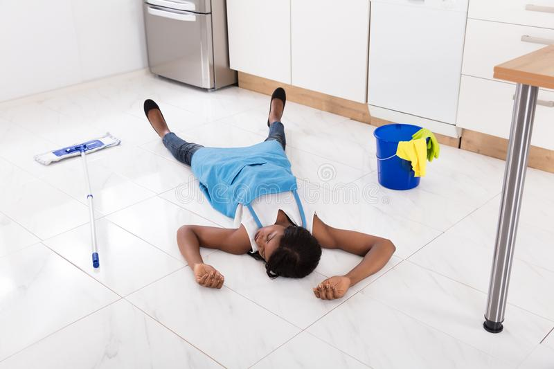 Unconscious Housewife Lying On Kitchen Floor royalty free stock images