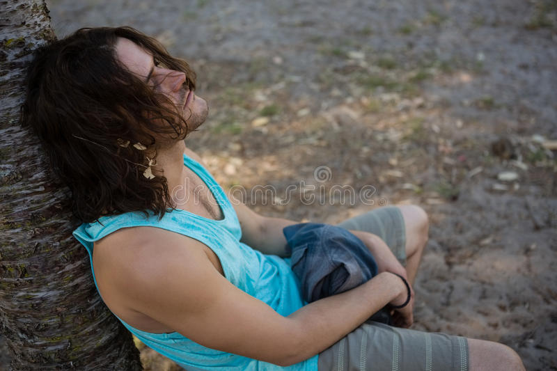 Unconscious man sleeping in the park royalty free stock photography