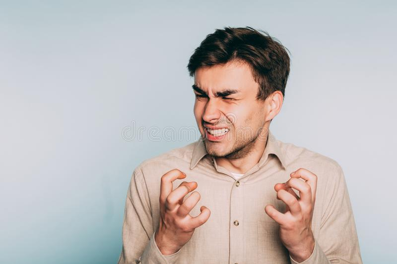 Uncontrollable anger helplessness despair man face royalty free stock photo