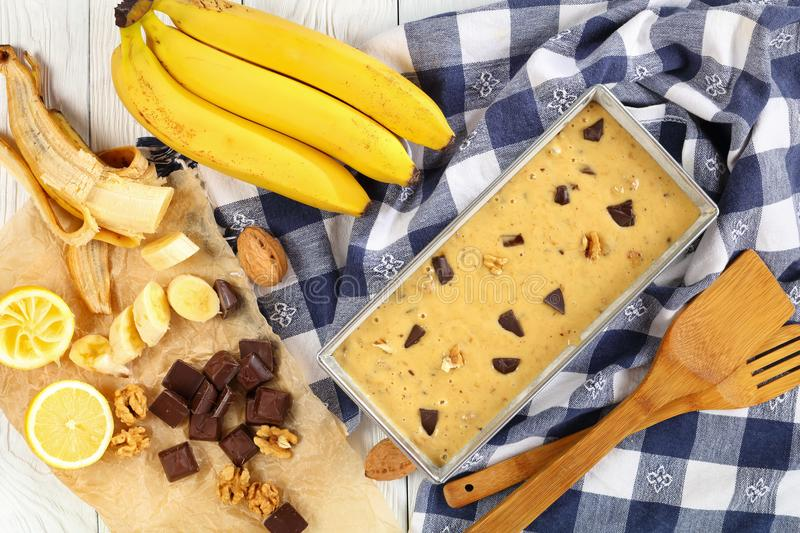 Uncooked banana bread in a loaf pan stock photos