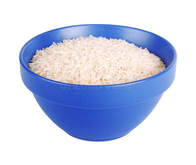 Uncooked basmati rice in a ceramic blue bowl. On white isolated background royalty free stock images