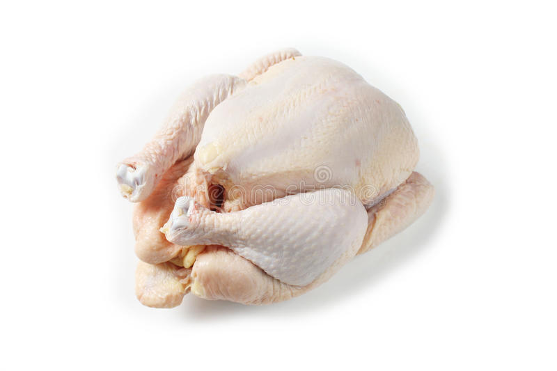 Uncooked chicken on white background stock photos