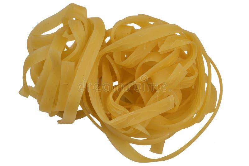 Uncooked dried wheat flour pasta stock photos