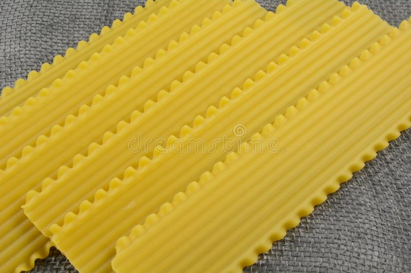 Uncooked dry lasagna noodles royalty free stock photo
