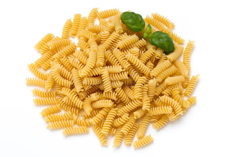 Uncooked fusilli pasta isolated white background. Uncooked fusilli pasta isolated white background royalty free stock photos