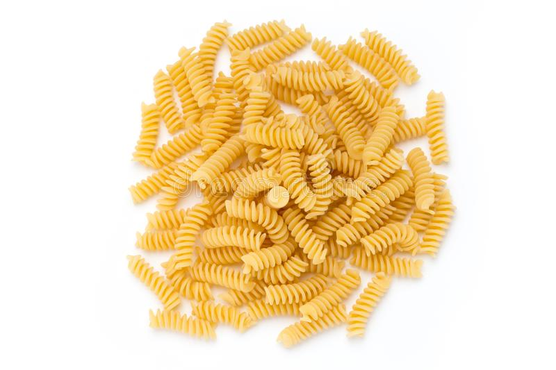 Uncooked fusilli pasta isolated white background. Uncooked fusilli pasta isolated white background stock photography