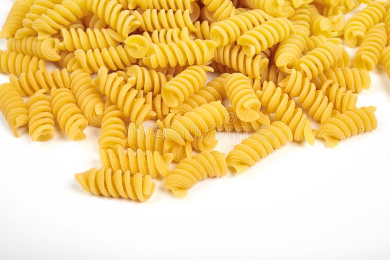 Uncooked fusilli pasta noodles isolated on white background.  stock photo