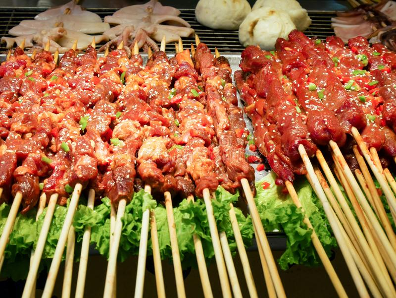 Uncooked meat skewers. In the restaurant royalty free stock photography