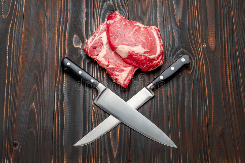 Uncooked organic shin of beef meat. On wooden table stock images