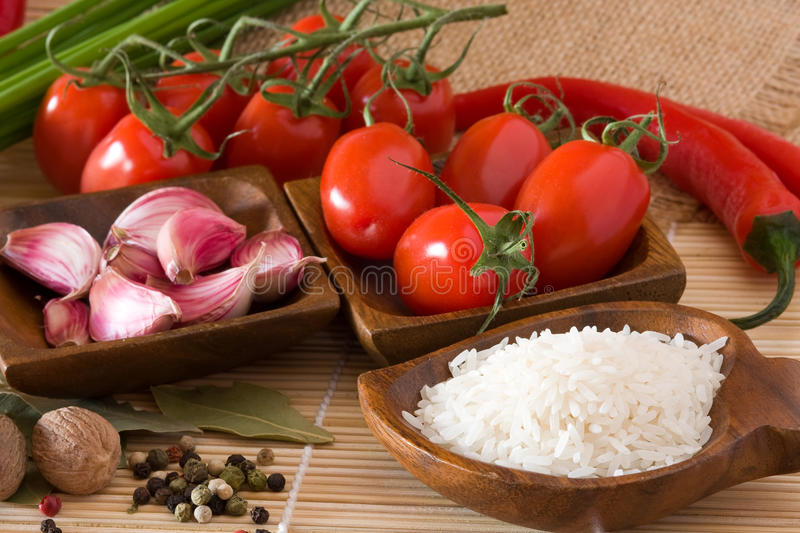 Uncooked rice in bowl stock photo
