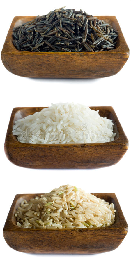 Uncooked rice in bowls royalty free stock photography
