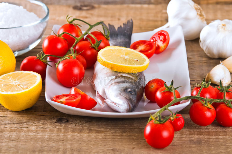Uncooked sea bass. Image of uncooked sea bass on white dish stock image