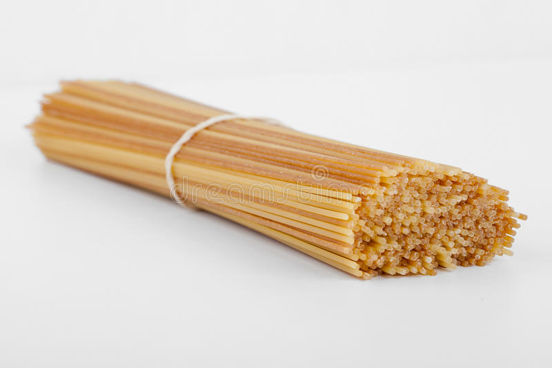 Uncooked spaghetti in a bundle royalty free stock photography