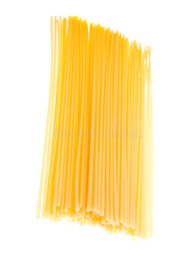 Uncooked spaghetti noodles isolated royalty free stock photo