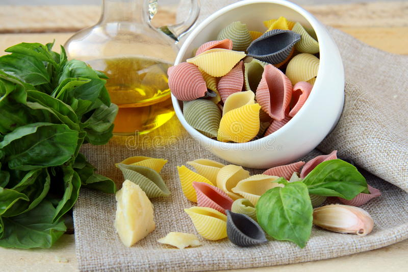 Uncooked tricolor pasta in cup royalty free stock image