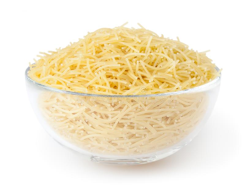 Uncooked vermicelli pasta in glass bowl isolated on white background. With clipping path stock photography