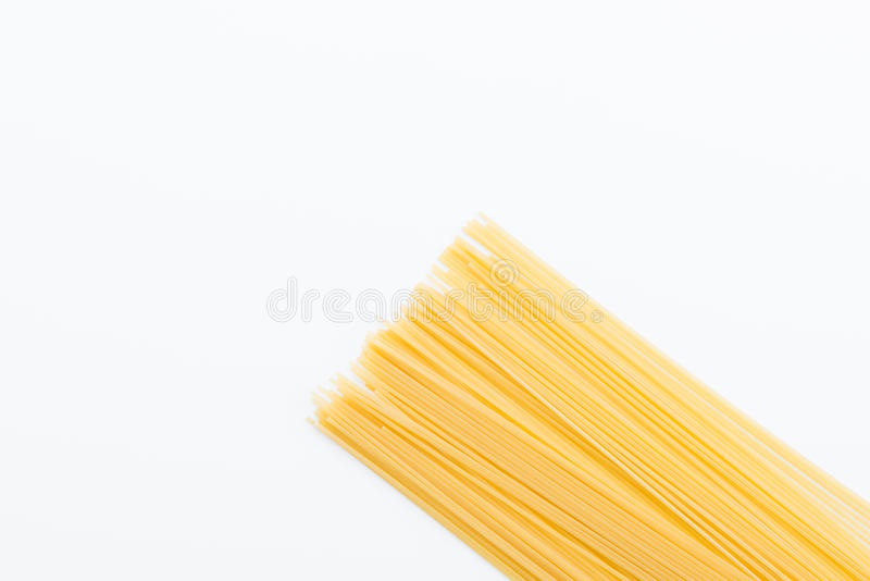 Uncooked vermicelli for pasta. Top view of raw vermicelli for making pasta on white royalty free stock image
