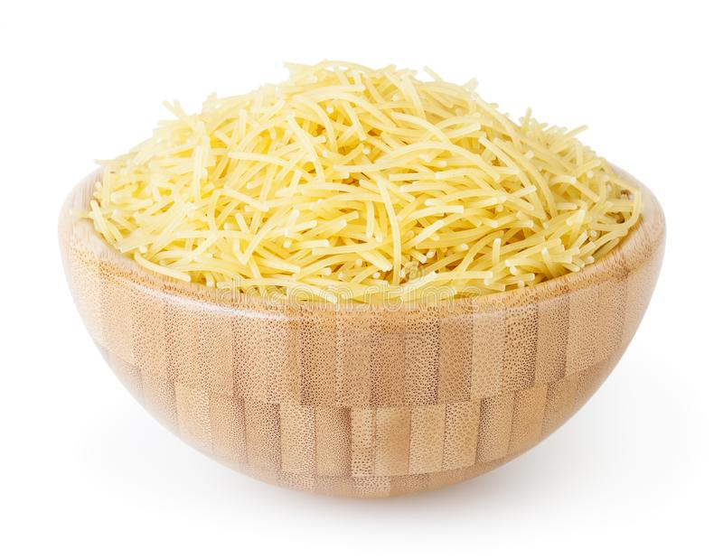 Uncooked vermicelli pasta in wooden bowl isolated on white background. With clipping path stock photos