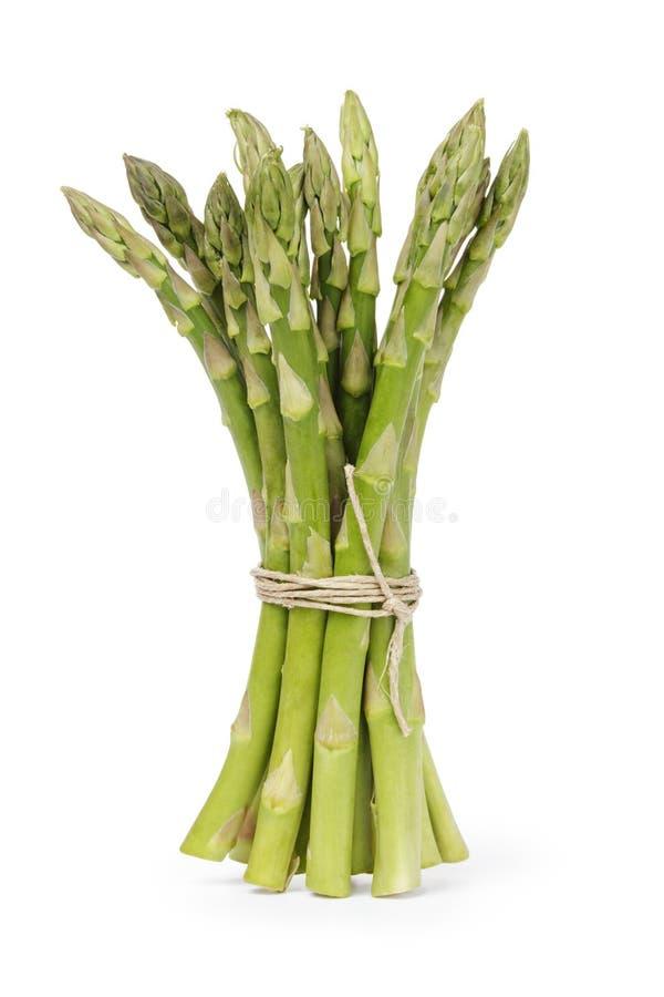 Uncooked zielony asparagus wiążący z dratwą zdjęcia royalty free