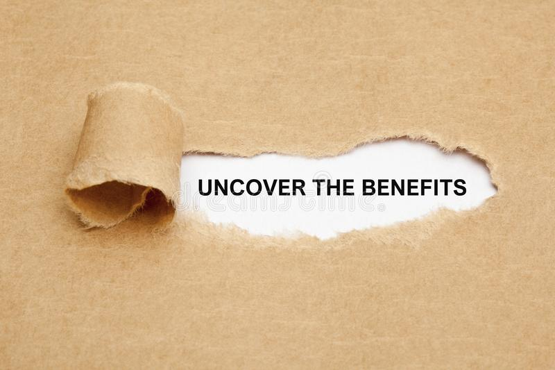 Uncover The Benefits Torn Paper. Text Uncover The Benefits appearing behind ripped brown paper stock images