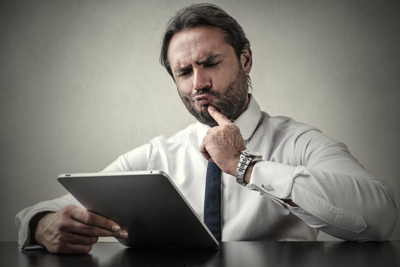 Undecided businessman royalty free stock image