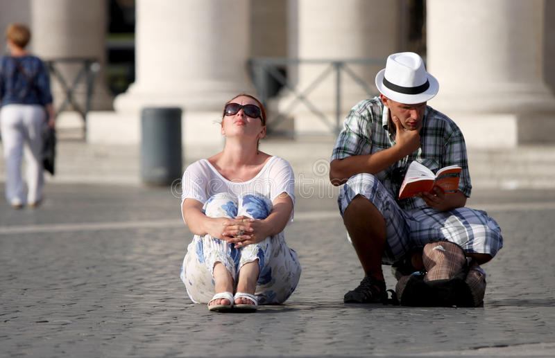 Undecided tourists couple looking at a guide book stock photos