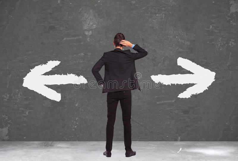 Undecided young business man royalty free stock image