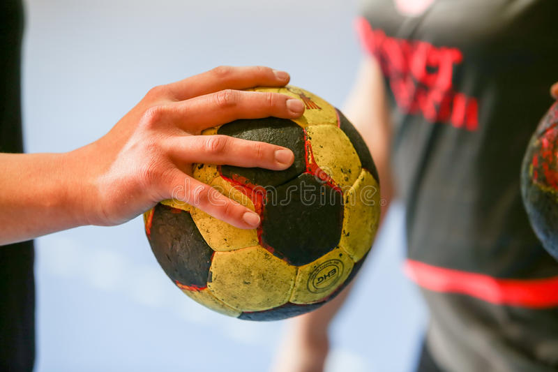 Undefined hands holding a ball prior to the Greek Women Cup Final handball game Arta vs Nea Ionia. Thessaloniki, Greece - February 13, 2016: Undefined hands stock photo