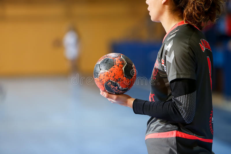 Undefined hands holding a ball prior to the Greek Women Cup Final handball game Arta vs Nea Ionia. Thessaloniki, Greece - February 13, 2016: Undefined hands royalty free stock photos