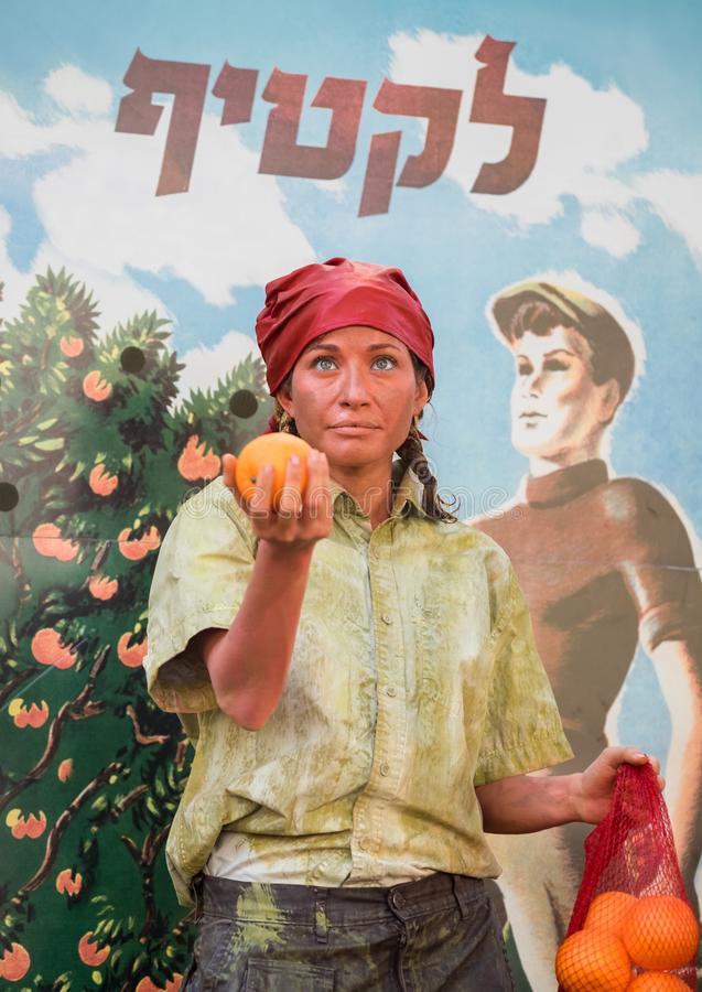 Undefined oranges harvester girl participant of Rehovot International Live Statues Festival stock images