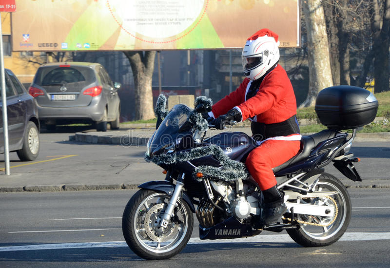 Undefined Santa delivering humanitarian aid in form of gifts to disabled children. BELGRADE, SERBIA - DECEMBER 26: Undefined Santa delivering humanitarian aid in royalty free stock photography