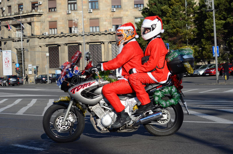 Undefined Santa delivering humanitarian aid in form of gifts to disabled children during annual Santa Claus Motorcycle Parade on royalty free stock photos