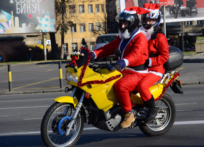 Undefined Santa delivering humanitarian aid in form of gifts to disabled children during annual Santa Claus Motorcycle Parade on. BELGRADE, SERBIA - DECEMBER 27 royalty free stock image