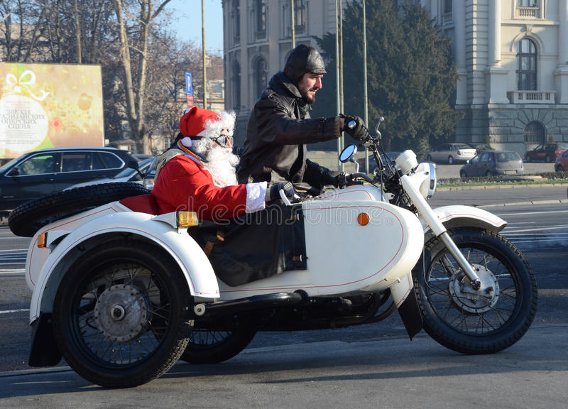 Undefined Santa delivering humanitarian aid in form of gifts to disabled children. BELGRADE, SERBIA - DECEMBER 26: Undefined Santa delivering humanitarian aid in royalty free stock images