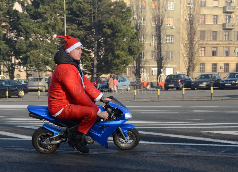Undefined Santa delivering humanitarian aid in form of gifts to disabled children. BELGRADE, SERBIA - DECEMBER 26: Undefined Santa delivering humanitarian aid in stock photo