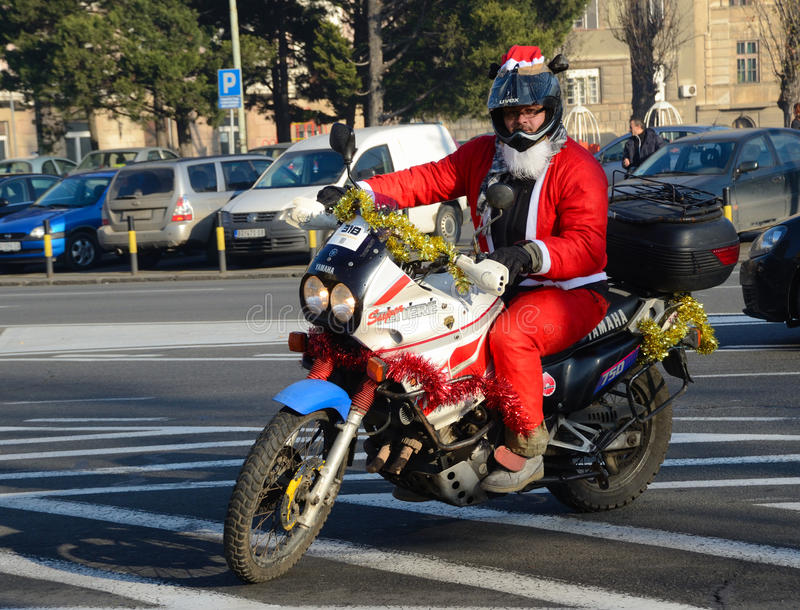 Undefined Santa delivering humanitarian aid in form of gifts to disabled children. BELGRADE, SERBIA - DECEMBER 26: Undefined Santa delivering humanitarian aid in royalty free stock photo