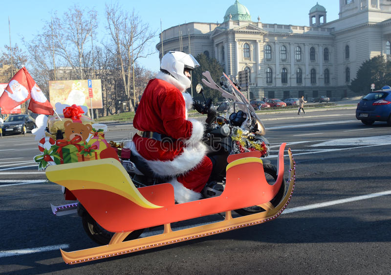 Undefined Santa delivering humanitarian aid in form of gifts to disabled children. BELGRADE, SERBIA - DECEMBER 26: Undefined Santa delivering humanitarian aid in royalty free stock photos