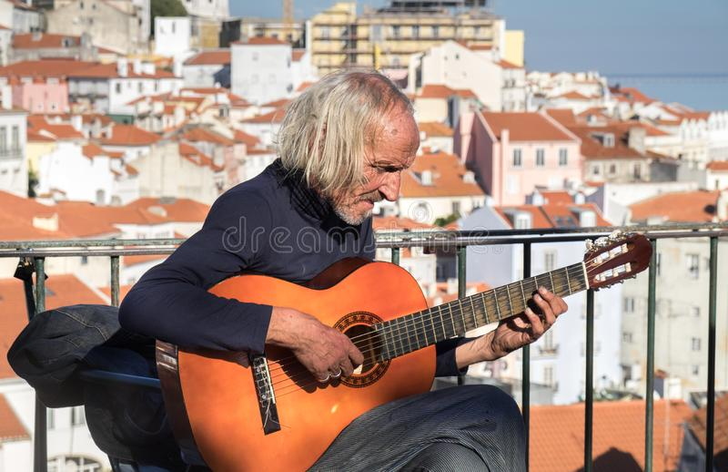 Undefined senior street guitarist play and sing Fado in Lisbon. Portugal royalty free stock photography
