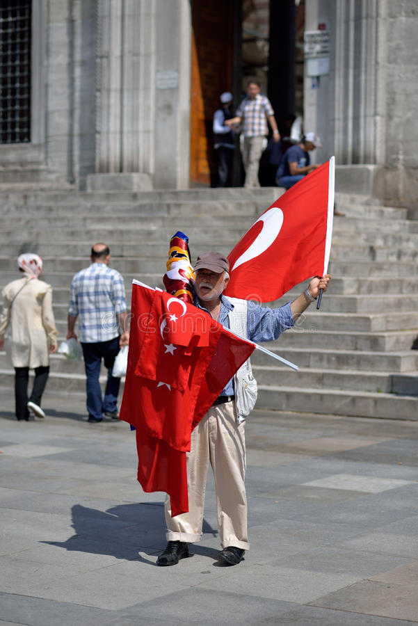 Undefinied street vendor selling turkish flag, Istanbul, Turkey. royalty free stock image