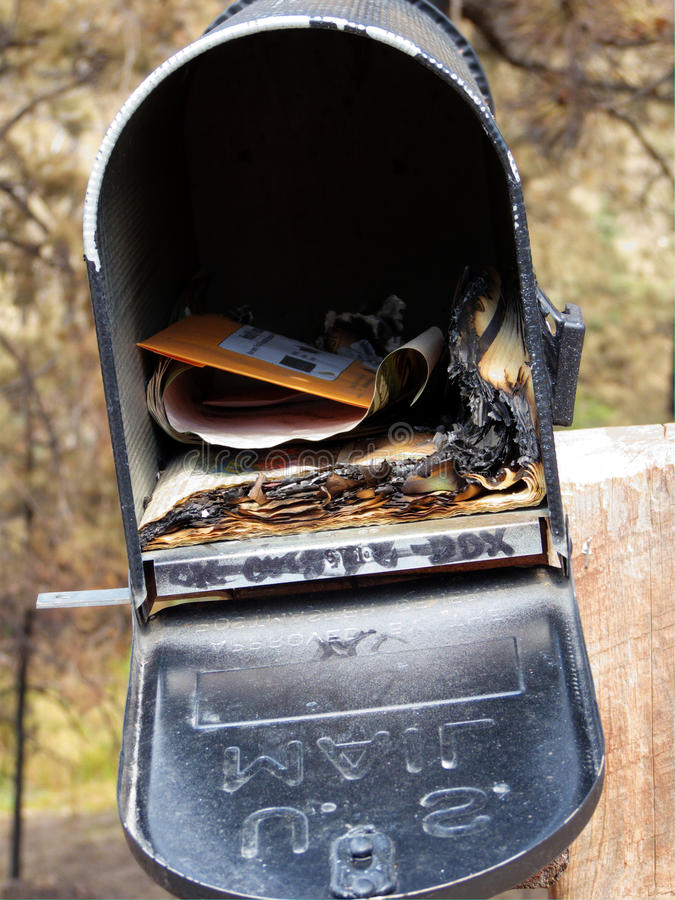 Undeliverable. Charred mail in burn zone of major US wildfire royalty free stock photo
