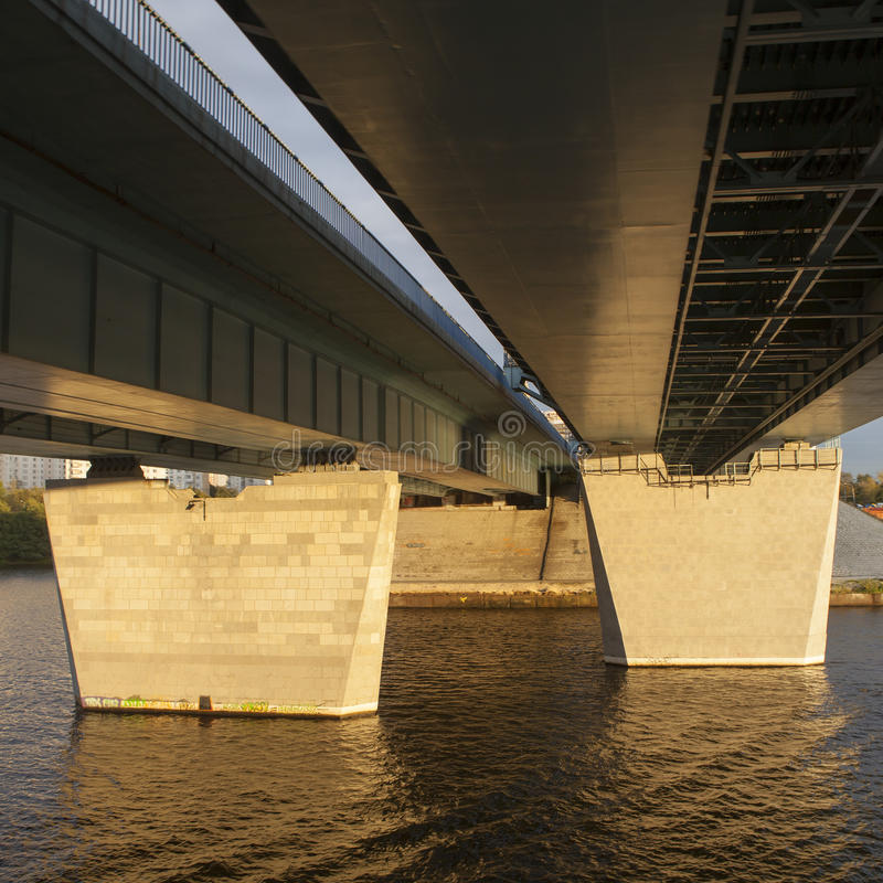 Under bridge perspective from ship in sunset stock images