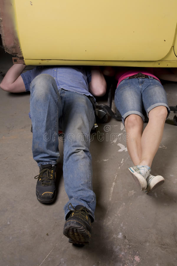 Under Car Legs Royalty Free Stock Images